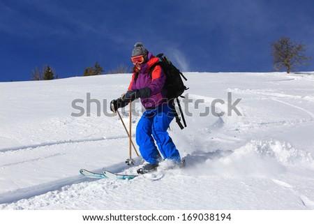 A woman skiing in fresh powder snow, Utah, USA.