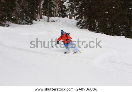 A woman skiing in the Utah mountains, USA.