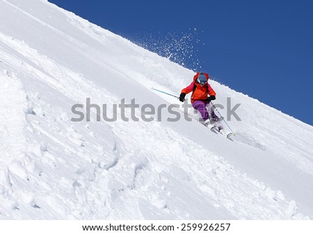 A woman skiing on a sunny winter day, Utah, USA.