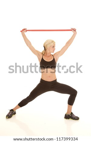 A woman stretching out using a rubber band.