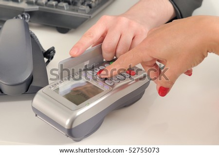 A woman swiping a credit card.