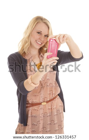 A woman taking a picture of herself with her cell phone.