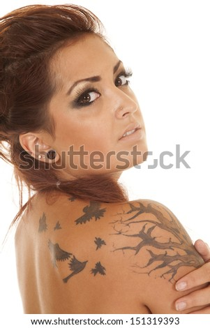 Stock Photo A woman up close with tattoos on shoulder.