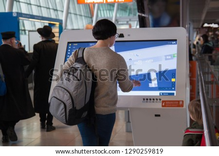 A woman using digital media blank  at the airport, screen modern panel, signboard for advertisement design in a shopping center, gallery.  #1290259819