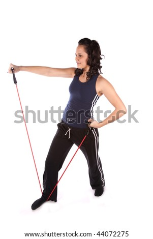 A woman using exercise bands with a small smile on her face.