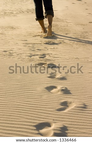 A Woman walking along the beach