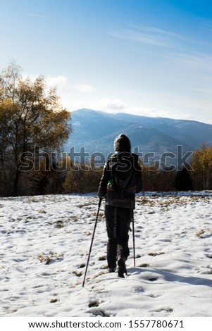 A woman walks in the mountains Nordic Walking