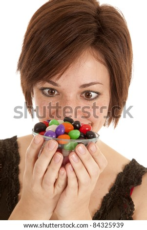 A woman wanting the whole bowl of jelly beans.