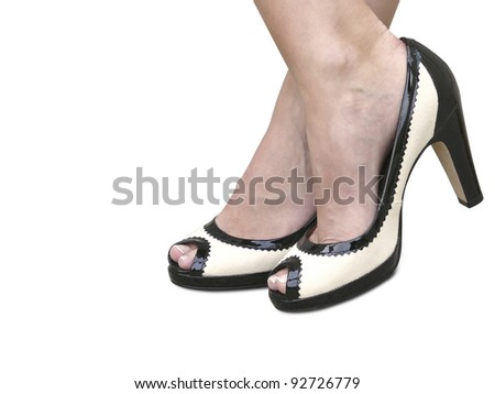 A woman wearing a pair of black & white classic high heels with clipping path.