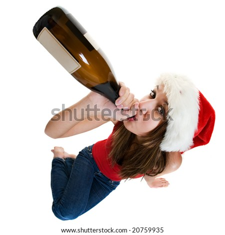 A woman wearing a santa cap drinking champagne.