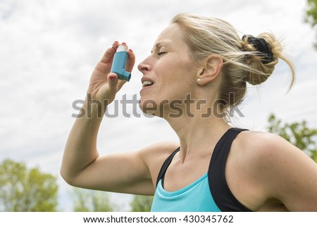 A woman who have a asthme crisis outside #430345762