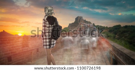 a woman with a backpack travels along the Great Wall of China. #1100726198
