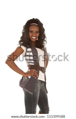 a woman with a big smile on her lips with her hands on her hips showing some attitude.