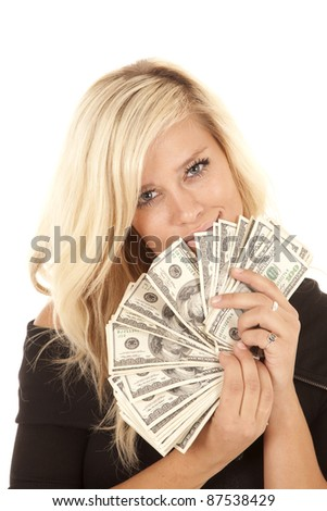 A woman with a fan of money with a smile on her lips.