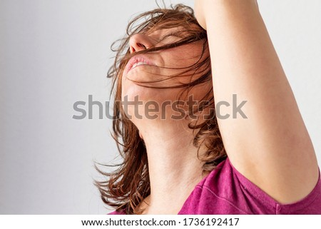 A woman with a gesture of despair and concern