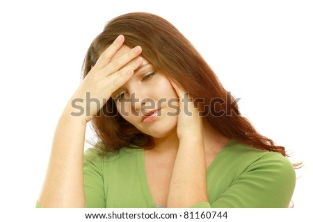A woman with a headache holding her hand to the head - isolated on white - stock photo