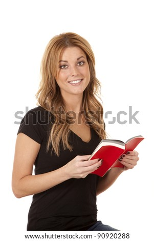 a woman with a huge smile on her face holding her book open.