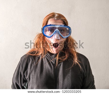 a woman with a scuba mask #1203333205