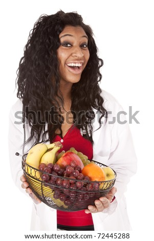 A woman with a stethoscope is holding a fruit basket.