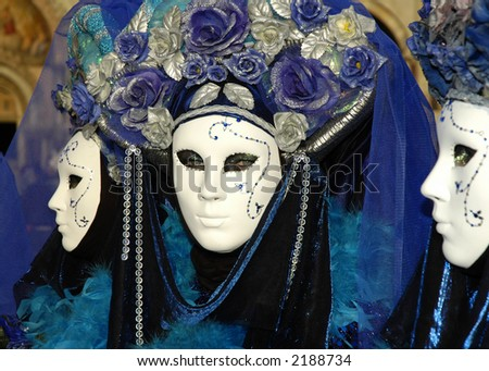 a woman with beautiful eyes looks out from behind a mask at Carnivale in Venice,Italy