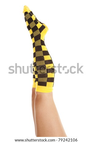 a woman with her legs up showing off her yellow and black check socks.