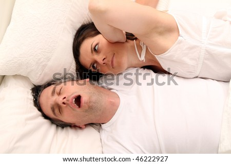 a woman with her snoring husband