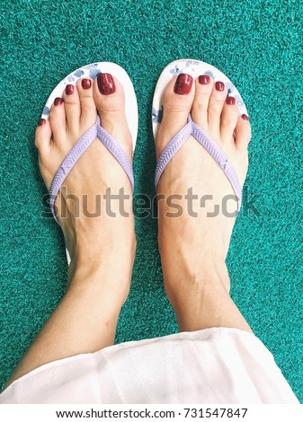 Mature feet red toes