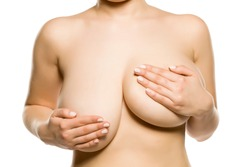 A woman with univen big breasts on white background