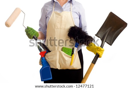 A woman with various spring cleaning and redecorating items including a paint brushes, garden tools, cleaning chemicals and items.  Spring time chores