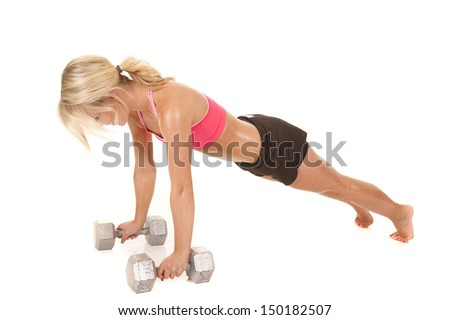 a woman working out by doing push ups on her weights.