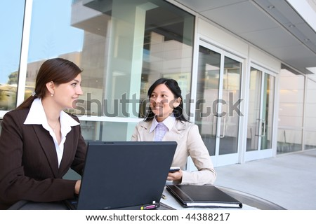 A women business team at their company office building