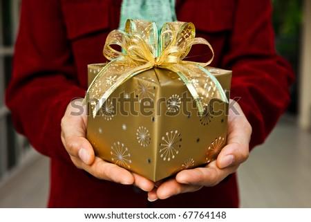 A women hand offering a gift.