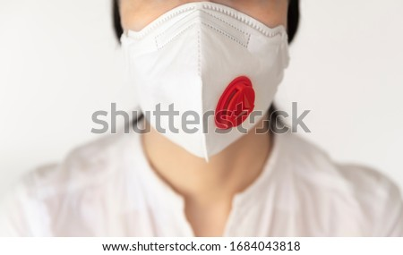 A women nurse wearing a valve mask for protection from viruses. Stock photo ©