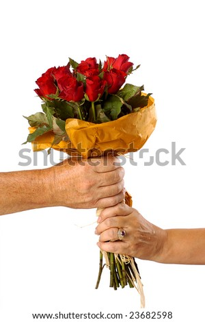 A women receiving red roses from a man