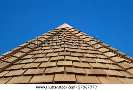 a wonderful blue sky behind a cladded wooden roof