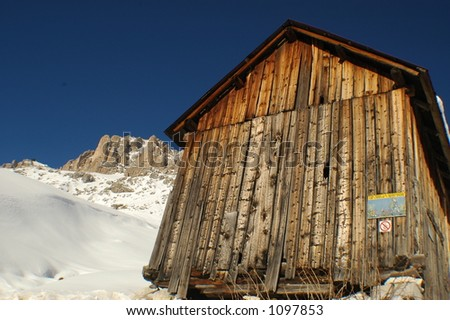a wood cabin left from World war two is now part of a hut system for skiers an mountaineers to cross the Alps