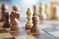 A wood chess on chess board with closeup shot.