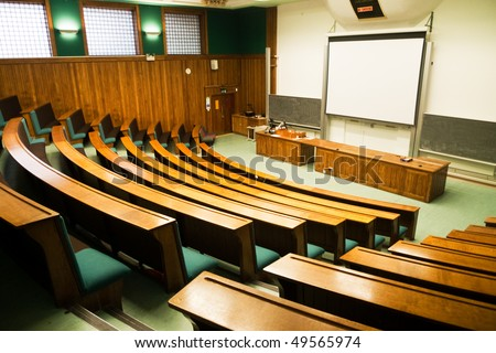 A wood panelled university lecture theatre/conference hall