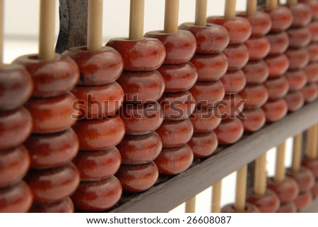 A wooden abacus in a studio shot, isolated on white.