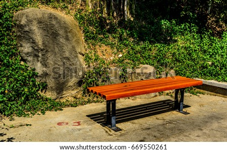 A Wooden Bench With A Green Grass Background An A Stone EZ Canvas - Stone picnic table