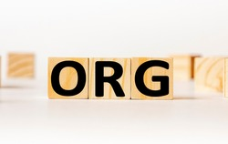 A wooden block with the word org written on it on a white background. Business concept