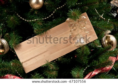 a wooden board on x-mas tree