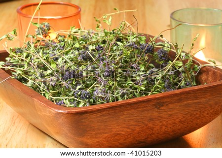 A wooden bowl full of dried herbs - Thymus serpyllum for cough