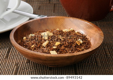 A wooden bowl of creamsicle rooibos tea