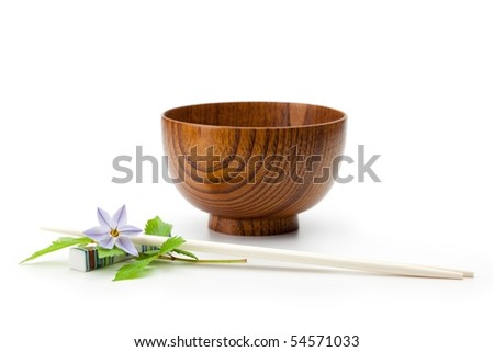 A wooden bowl (owan) and chopstick setting with lily. - stock photo