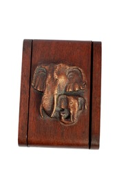 A wooden box on which two elephants are depicted. Jewelry box.