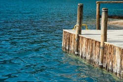 A wooden bridge extends into the sea. Selective focus. High quality photo