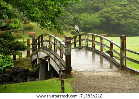 A wooden bridge in Hamarikyu Gardens in Tokyo, Japan. | EZ Canvas