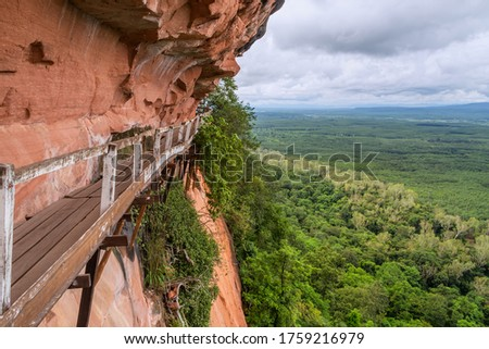 A wooden bridge on a high cliff,Phu Thok or Chetiyakiri Temple Beautiful mountain landscape with rocky cliffs,Bueng Kan Province,Thailand  Stockfoto ©