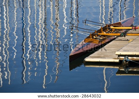 a wooden canoe to the dock at the port of Trieste